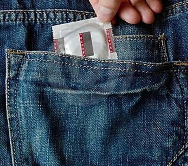 jeans-pocket-condom-hand-14882312